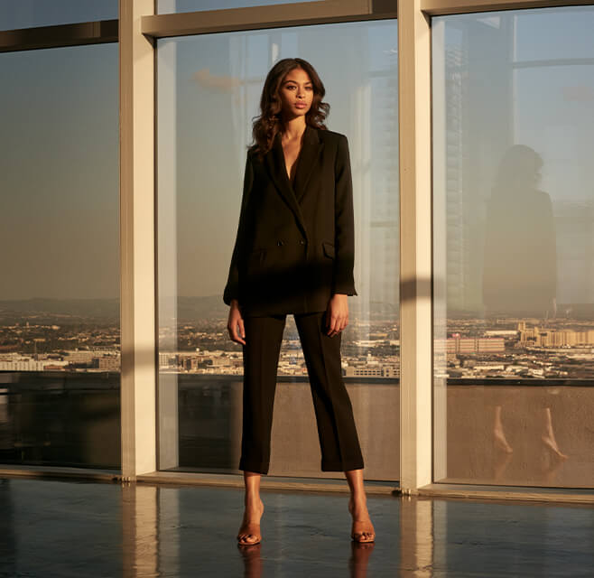 Woman with black blazer and trousers
