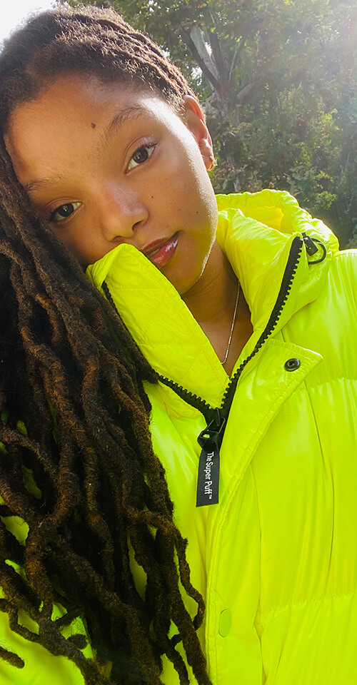 Halle in The Shorty Super Puff in Neon Sunray