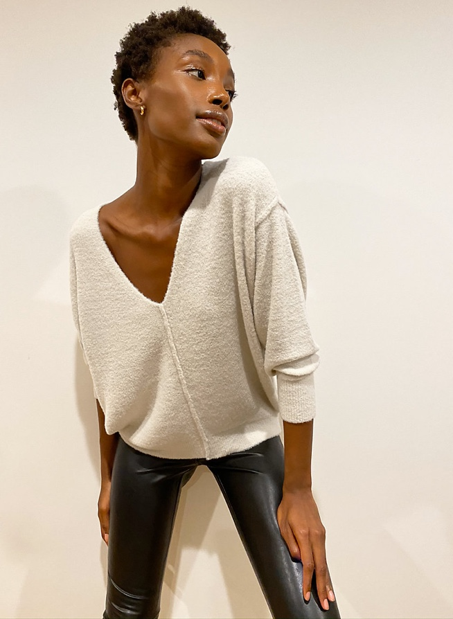 Woman wearing Aritzia clothing